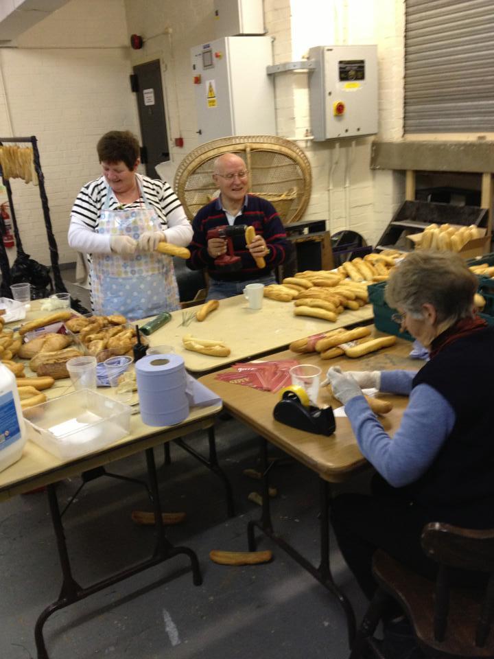 Volunteers creating Panto themed christmas decorations